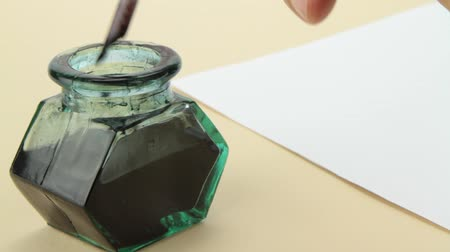 средневековый : Glass ink bottle with paper. Стоковые видеозаписи