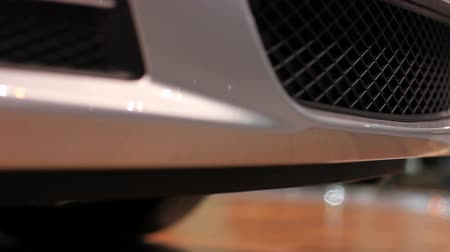 auto show : Close up front bumper of sports car at a car show Stock Footage