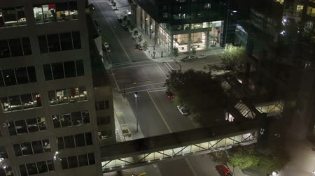 eye : A beautiful urban night time lapse shot looking down on the streets of downtown Calgary. Two shots, 1 zoom in and 1 zoom out.