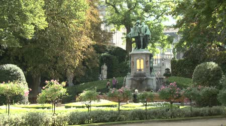 boxwood : Brussels, Petit Sablon square and garden with fountain and sculptures, Belgium Stock Footage