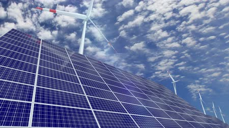 türbin : Solar panels and turning wind turbines against cloudscape Stok Video