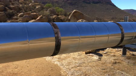 culvert : Long oil gas pipeline in desert environment Stock Footage