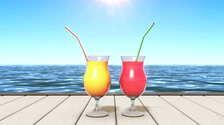 Two glasses with tasty tropical drinks at seaside