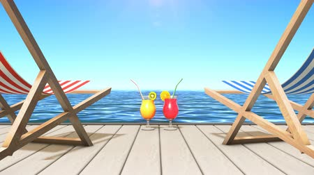 Two deck chairs and two glasses with tasty tropical drinks at a seashore Stock Footage