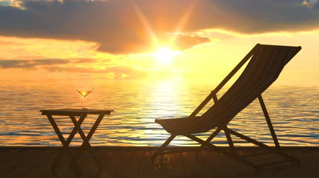 Deckchair and a table with a glass of wine at a seaside is a very nice quiet place for chill out and leisure Stock Footage