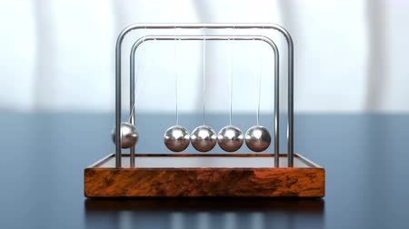 Looped animation of Newtons metal balls in slow motion