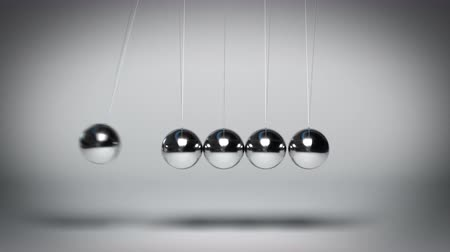 Looped animation of Newtons balls bouncing against gray background Stock mozgókép