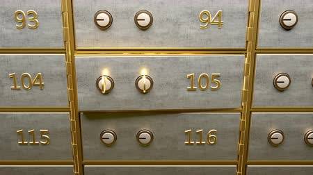 A door of safety deposit box with gold bars inside opened by two golden keys Stock Footage
