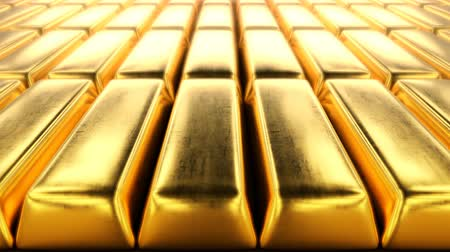 Unpolished rough gold bars, close-up view, seamless loopable video. A concept of ultimate wealth.