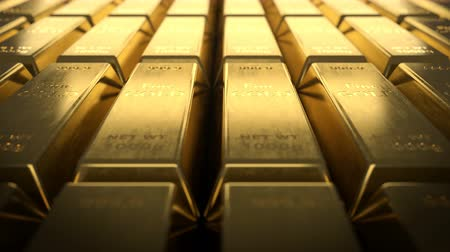 resmedilmeye değer : Loopable video of fine gold bullion bars. Close-up view of fine gold bars. Camera filming rows of fine gold ingots. Stok Video