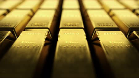 Close-up view of fine gold bars. Loopable video showing rows and rows of fine gold ingots. Camera showing each scratch on fine gold bullion bar surface with shallow depth of field.