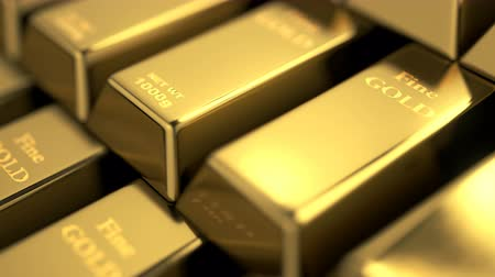 Close-up view of fine gold bars stack. Camera moving over stairs of fine gold bars. High resolution visualizing details on golden bars surface. Loopable seamless video. Stock Footage