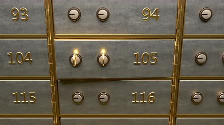 Camera showing safety deposit box door opening and a stack of fine gold bars laying inside the deposit box