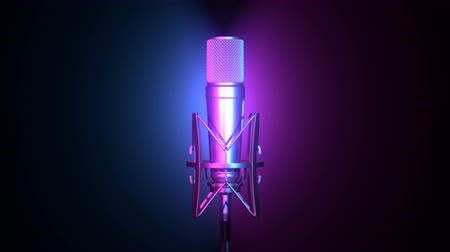 Professional microphone lit by cyan and magenta spot lights