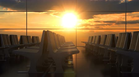 lobby : Airport departure hall with no people. Scenic sunset seen through the windows. Camera moving along rows of passenger chairs. Seamless loop.