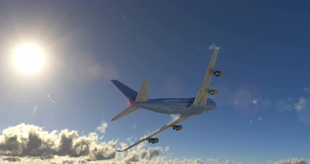 Large passenger airplane flying over cumulus clouds in evening sky under bright sun