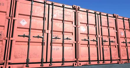 Camera moving slowly along red cargo shipping containers, seamless loop