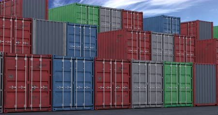 Camera moving slowly along multi-colored cargo shipping containers, seamless loop
