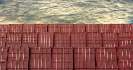 Cargo shipping container stacks under evening cloudscape. Cargo containers are excellent for cargo import export shipment.