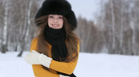 cold : Video of beautiful smiling female in luxurious fur head cloth outdoor in winter