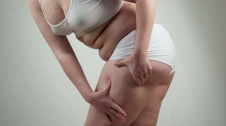 celulite : Side view of woman with fat belly. Obesity concept. Vídeos