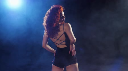 enticing : Sexual redhead woman dance in dancing swimsuit.