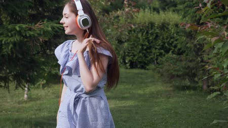 dj : Young woman with headphones listening music. Stock Footage