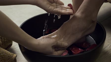 rítus : Woman washing beautiful legs in bowl. Stock mozgókép