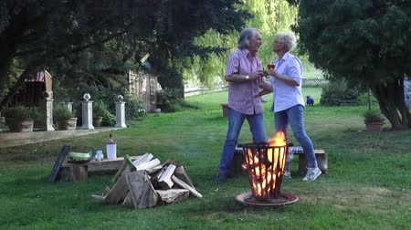 repousante : Happy couple meets by the campfire in the garden