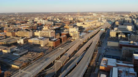 Aerial view of the american city at dawn. High-rise buildings, freeway, bay. Sunny morning. Milwaukee, Wisconsin, USA