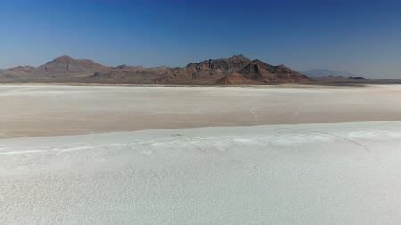 Bonneville Salt Flats in Utah near the Utah-Nevada border. Drone flying low over the salt flats.