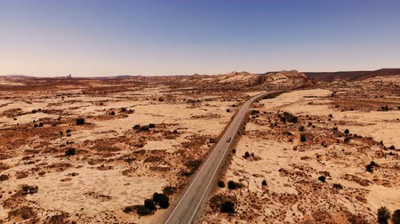 Desert, empty highway in Utah, USA. Scenic landscape. Nature, geology, environment of Utah. Traveling by motorhome (RV). View from above, aerial view, drone shot
