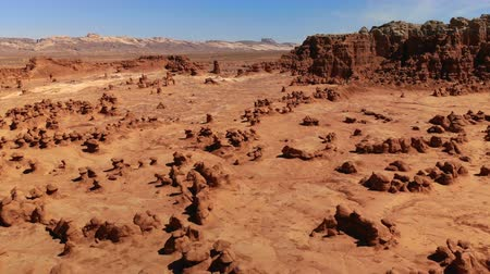 Hoodoos in Goblin Valley State Park, Utah, United States. Desert. Hoodoo rocks located along the San Rafael desert. Aerial view, from above, drone shot