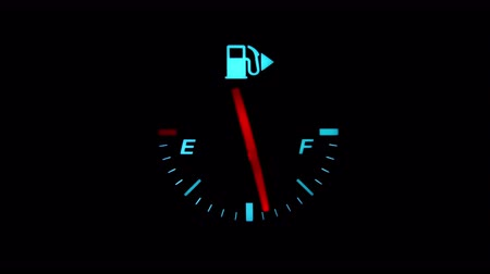 tachometer : CLOSE UP: Car is running out of gas very quickly Stock Footage