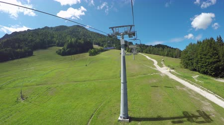 toboggan : Riding the chairlift on a beautiful summer day
