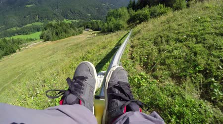toboggan : FIRST PERSON VIEW: Riding the summer sledge in ski resort