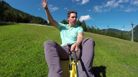 toboggan : Happy young man enjoying summer sledge rollercoaster in nature