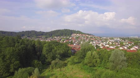 slovenya : AERIAL: Beautiful contemporary suburban town full of luxury suburb row houses on the edge of the forest in sunny spring Stok Video