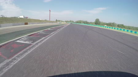 formuła : LOW ANGLE VIEW: Race car competing and driving fast on race track lap Wideo