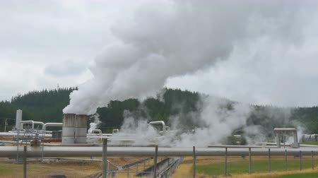 CLOSEUP: Polluting smoke and steam coming out of geothermal factory pipeline
