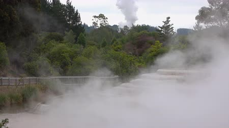 Steam rising from hot geothermal water terraces spring
