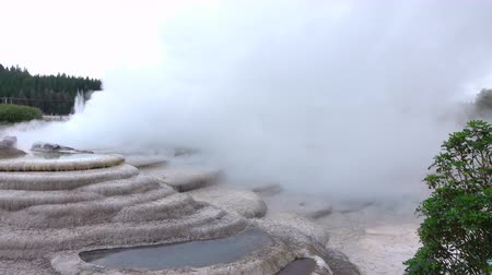 CLOSE UP: Beautiful natural hot water geothermal spring terraces steaming in Waikarei, New Zealand