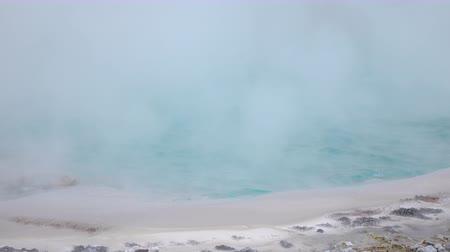 molas : CLOSE UP: Steam rising from hot geothermal water spring