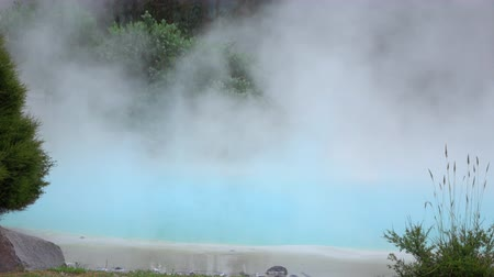 molas : CLOSE UP: Steam rising up from beautiful geothermal hot water spring in nature