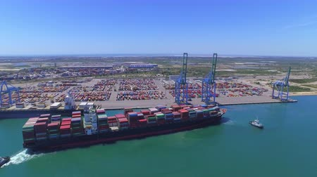 container terminal : AERIAL: Big container ship with shipping containers in freight harbor