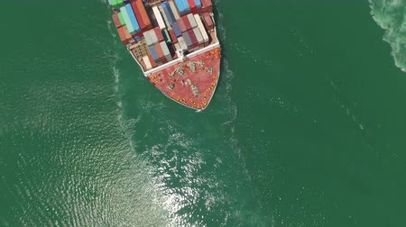 AERIAL: Huge container ship fully loaded with cargo shipping goods, freight transportation 무비클립