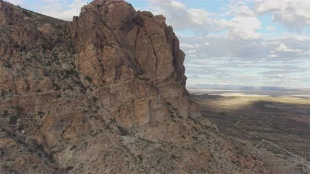 new mexico : AERIAL: Flying high over the rocky mountain in vast desert on a beautiful sunny day Stock Footage