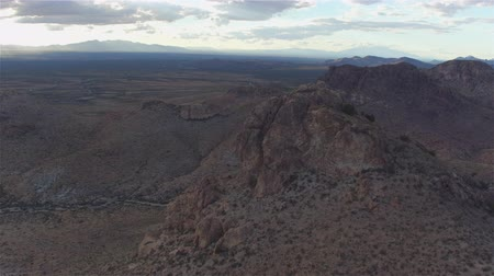 new mexico : AERIAL: Flying above big rocky mountain ridge in a desert Stock Footage