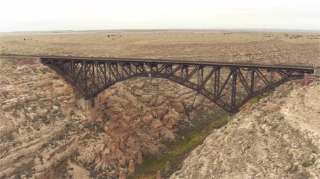 diablo : AERIAL: Flying around empty steel arch railroad bridge across the Canyon Diablo in the middle of the vast desert in Arizona