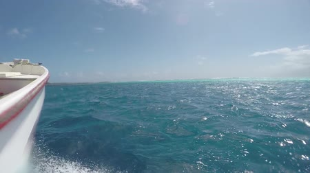 deep sea exploration : SLOW MOTION CLOSE UP: Boat ride towards the open ocean, water drops splashing into camera